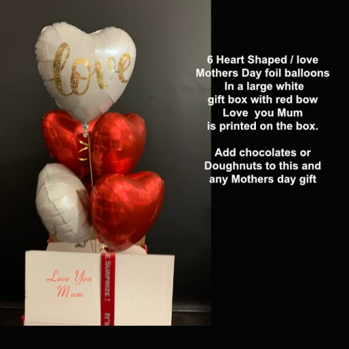 6 foil heart balloons in a box